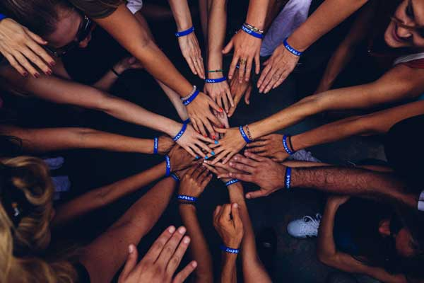Overhead shot of a group of hands